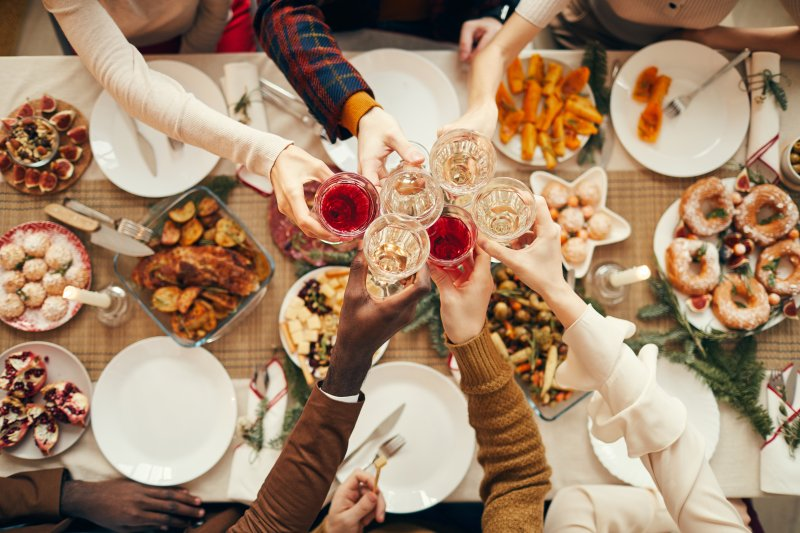 A group of people enjoying holiday dinner.