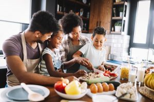 a family cooking a healthy meal during National Nutrition Month