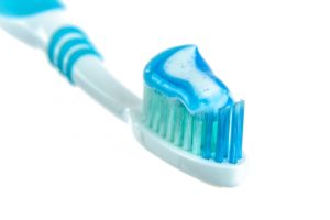 Toothbrush with toothpaste recommended by a dentist in Ocala.